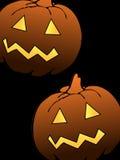 Twee enge Halloween pompoenen Royalty-vrije Stock Afbeelding