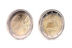 Twee euromuntstukken met schaduwen Stock Foto