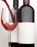 Twee flessen en glas rode wijn Royalty-vrije Stock Afbeelding