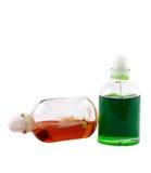 Twee flessen met aromatische oliën Stock Foto's