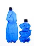 Twee flessen plastiek Stock Afbeeldingen