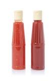Twee flessen saus stock fotografie