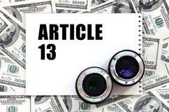 Twee fotografisch lenzen en notitieboekje met artikel 13 inschrijving royalty-vrije stock foto