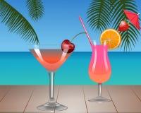twee fruitcocktails op een tropisch strand royalty-vrije illustratie
