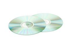 Twee geïsoleerde_ CDschijven Stock Afbeeldingen