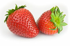 Twee geïsoleerdea aardbeien Stock Afbeeldingen