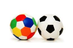 Twee geïsoleerdeh voetballen Stock Foto