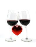 Twee geïsoleerden wijnglazen en hart Stock Foto's