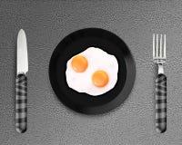 Twee gebraden eieren op een Plaat Royalty-vrije Stock Fotografie