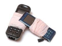 Twee gebroken celtelefoons Royalty-vrije Stock Foto's