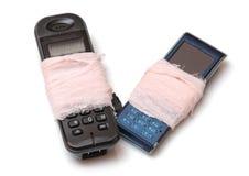 Twee gebroken celtelefoons Stock Foto