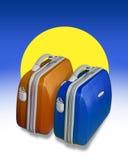 Twee gekleurde koffers Stock Foto's