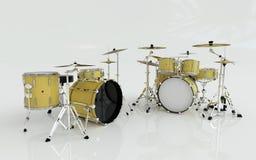 Twee gele of gouden die trommels in de witte ruimte worden geplaatst Stock Fotografie