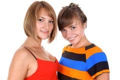 Twee gelukkige jonge vrouwen Stock Foto