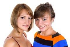 Twee gelukkige jonge vrouwen Royalty-vrije Stock Afbeeldingen