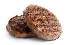 Twee geroosterde hamburgerpasteitjes op wit Stock Fotografie