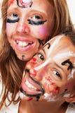 Twee geschilderde gezichten Stock Afbeeldingen