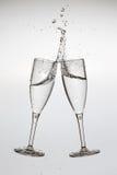 Twee Glazen met plons Stock Afbeelding
