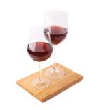Twee glazen van de rode geïsoleerde wijn Stock Foto's