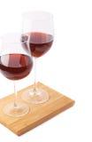 Twee glazen van de rode geïsoleerde wijn Stock Fotografie