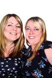 Twee glimlachende vrouwen Stock Afbeeldingen
