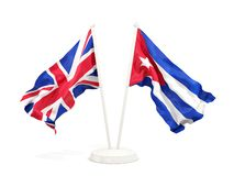 Twee golvende die vlaggen van UK en Cuba op wit wordt het geïsoleerd stock illustratie