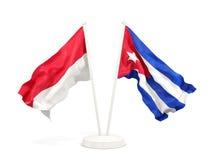 Twee golvende vlaggen van Indonesië en Cuba dat op wit wordt geïsoleerd stock illustratie