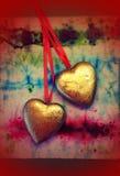 Twee gouden harten Stock Afbeelding