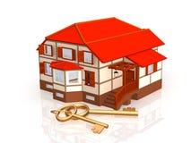 Twee gouden sleutels, die dichtbij aan een plattelandshuisje leggen Royalty-vrije Stock Afbeelding