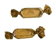 Twee gouden snoepjesclose-up Stock Foto