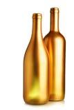 Twee gouden wijnflessen Royalty-vrije Stock Afbeeldingen