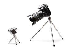 Twee groot en kleine camera's Stock Afbeeldingen