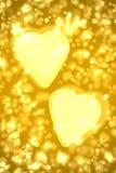 Twee grote gouden harten Stock Foto's