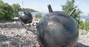 Twee grote overzeese mijnen van de oude die oorlog op de grond GH4 4K UHD wordt geplaatst stock video