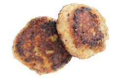 Twee hamburgers die over wit worden geïsoleerd Stock Foto