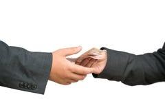 Twee handen en geld Stock Foto's
