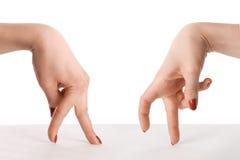 Twee handen gaan elkaar ontmoeten Stock Foto