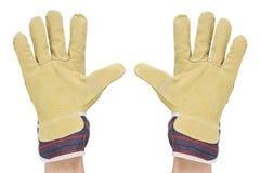 Twee handen met het werkhandschoenen Stock Afbeelding