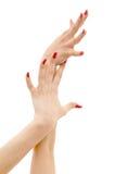 Twee handen met rode spijkers Royalty-vrije Stock Afbeeldingen