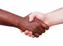 Twee handen schudden, zwart-wit op achtergrond stock afbeelding