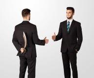 Twee handen van de zakenmanschok stock foto's