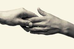 Twee handen - zorg Stock Afbeelding