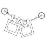 Twee hangende fotokaders met klemmen op de kabel en siliconezuignappen Stock Foto