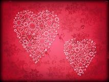 Twee harten op een rode achtergrond Royalty-vrije Stock Afbeeldingen
