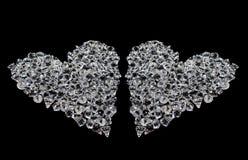 Twee harten van diamanten op zwarte Royalty-vrije Stock Afbeeldingen