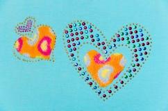 Twee hartpluis en lovertje Stock Fotografie