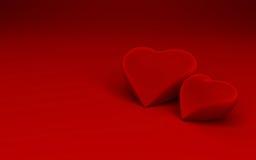 Twee hartvormen op rode achtergrond Stock Fotografie