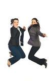 Twee het bedrijfsvrouwen springen royalty-vrije stock fotografie