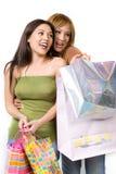 Twee het gelukkige dames winkelen Royalty-vrije Stock Fotografie