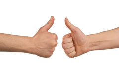 Twee het mannelijke handen omhoog beduimelt tonen Stock Afbeelding